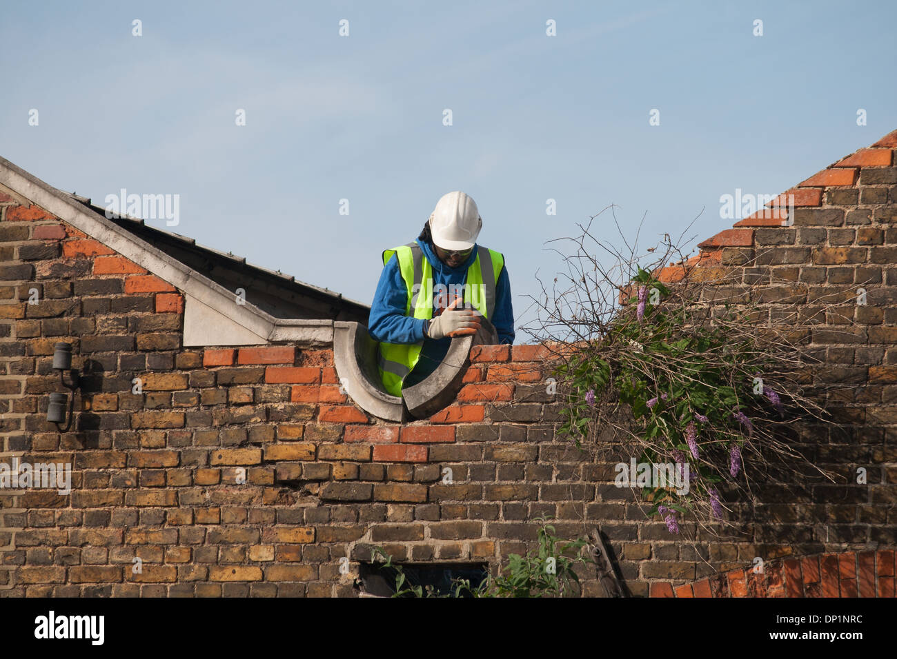 Demolition of industrial Victorian electricity buildings for redevelopment as housing in Twickenham, London, UK - Stock Image