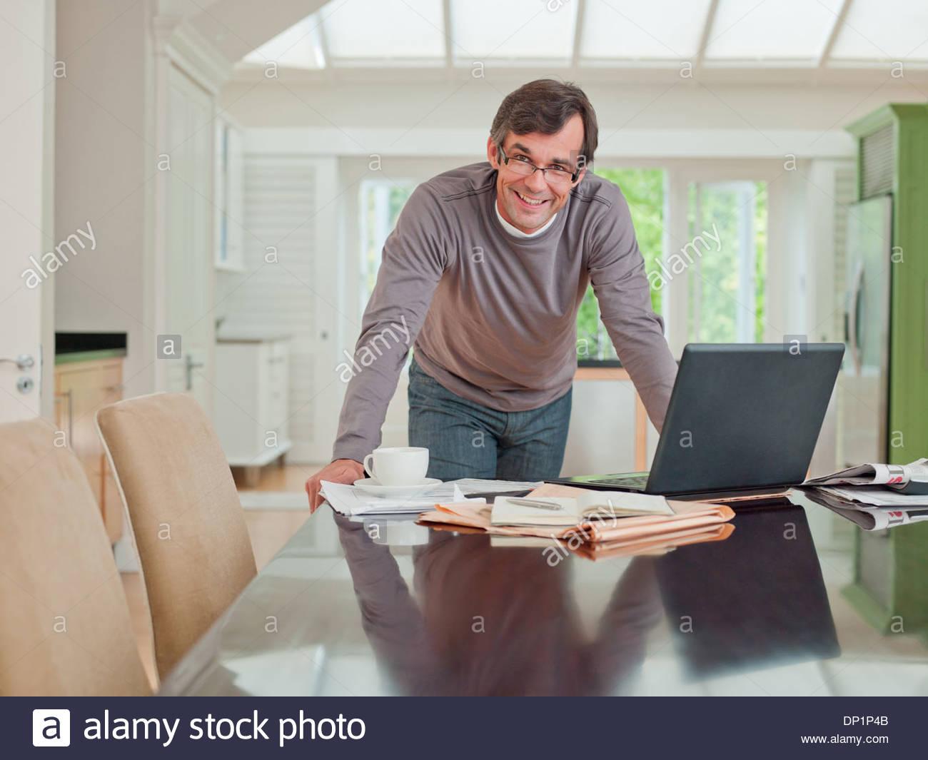 Man looking at laptop Stock Photo