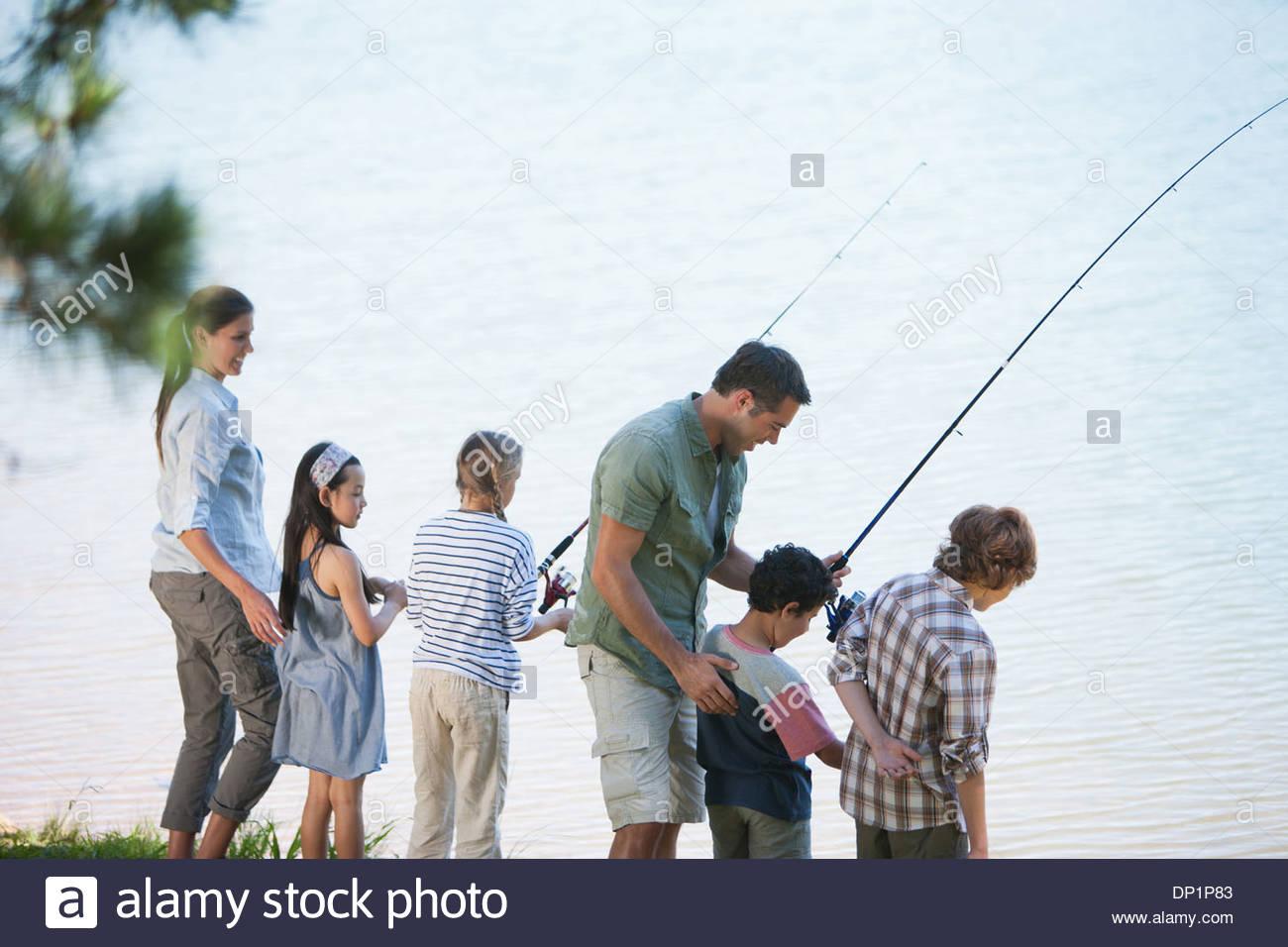 Family fishing in lake - Stock Image