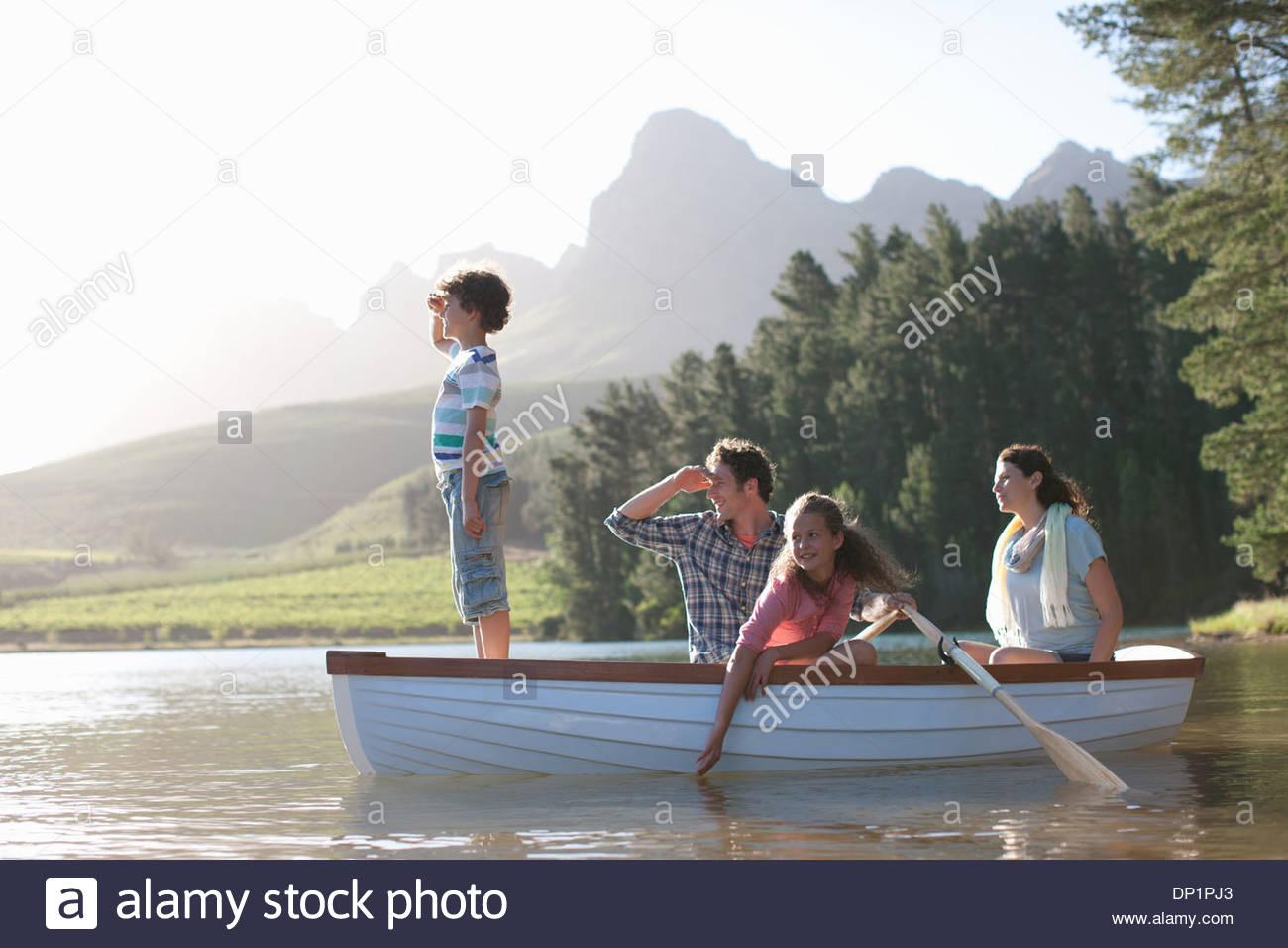 Family in rowboat on lake - Stock Image