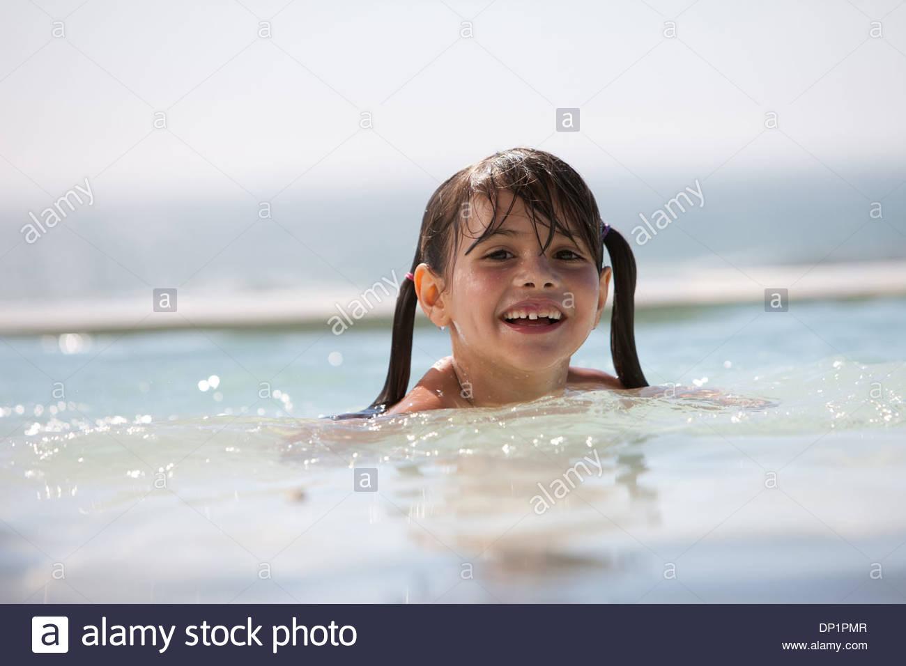 Girl in swimming pool - Stock Image