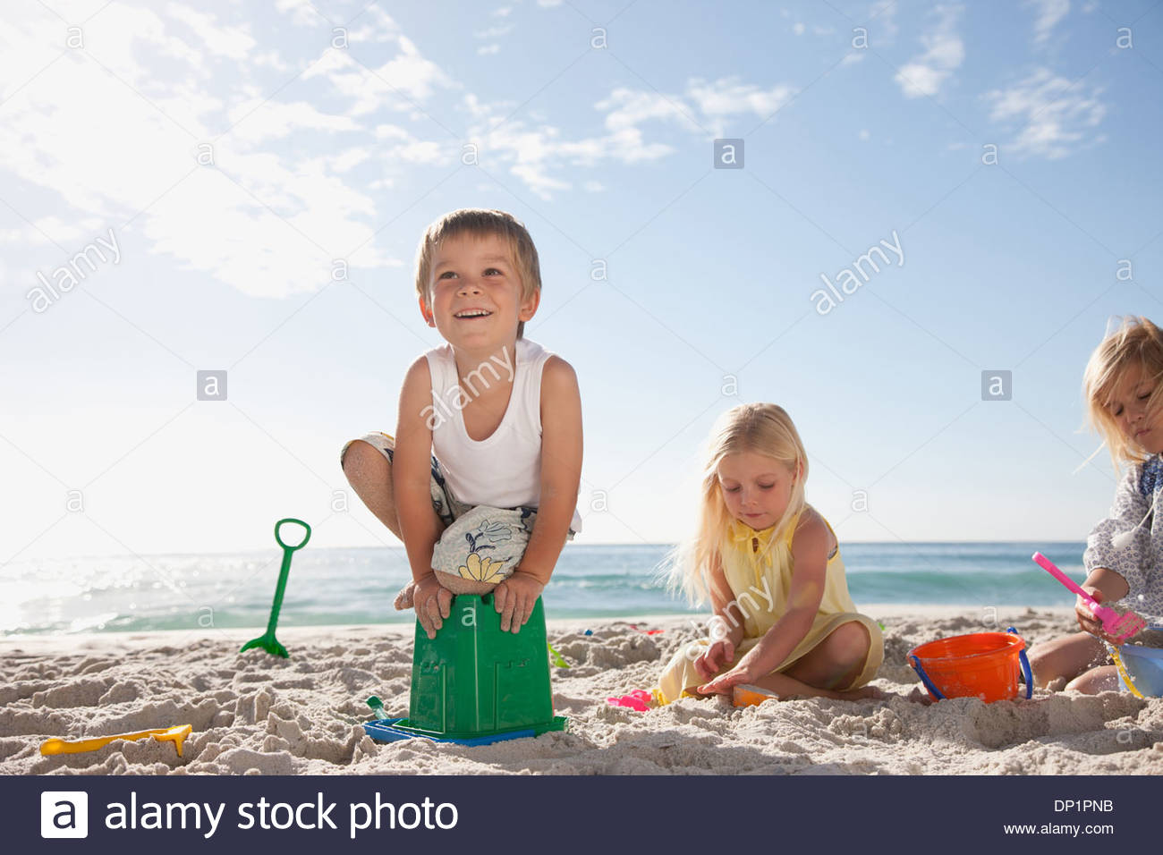Kids playing on beach - Stock Image