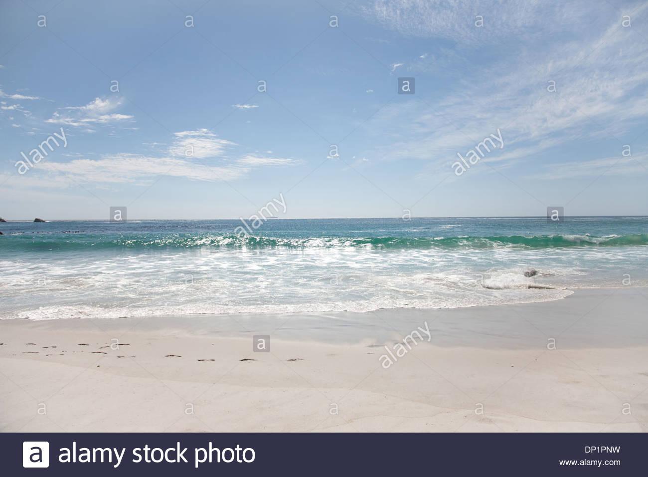 Surf along beach - Stock Image