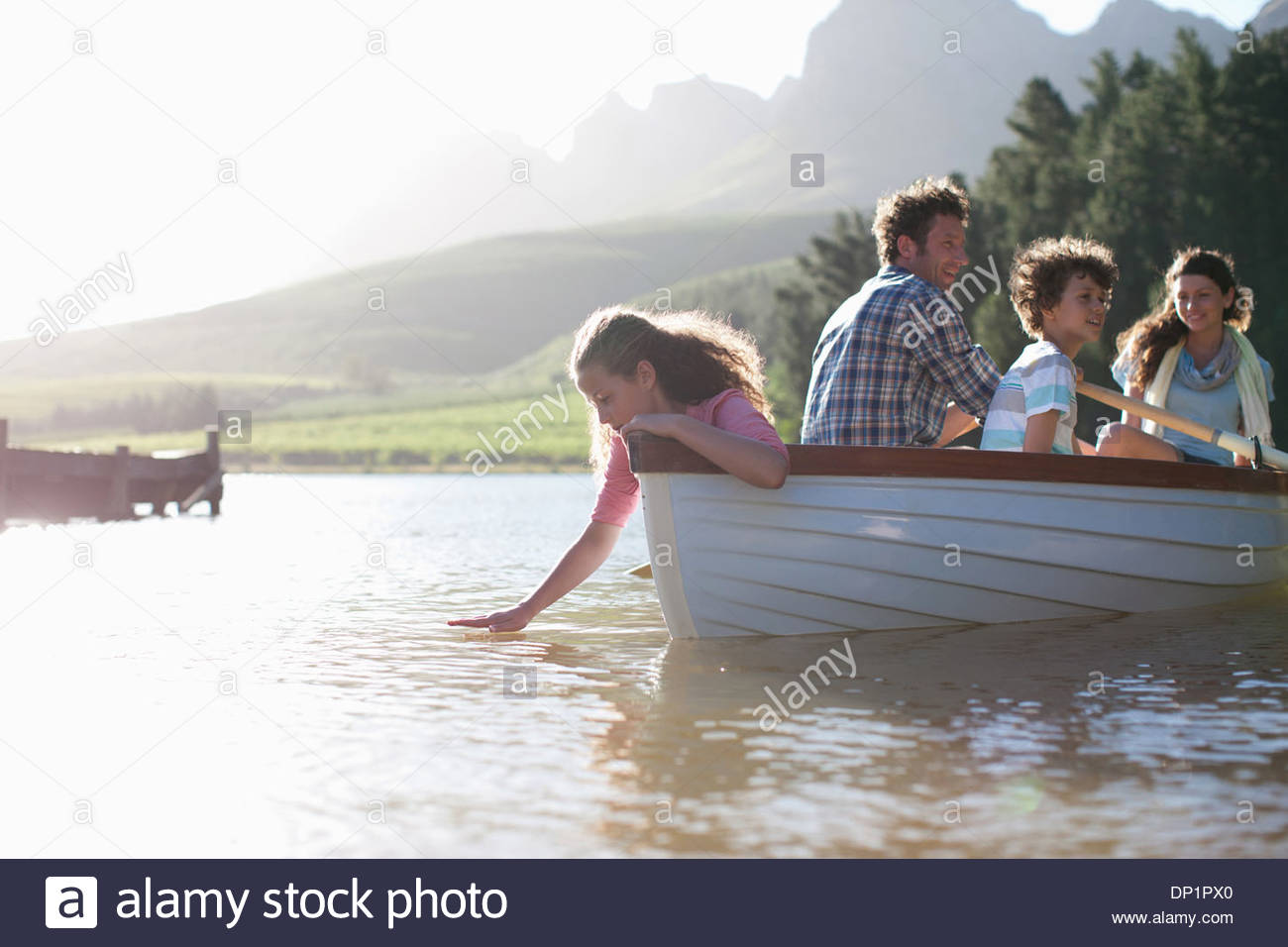 Family in rowboat on lake Stock Photo