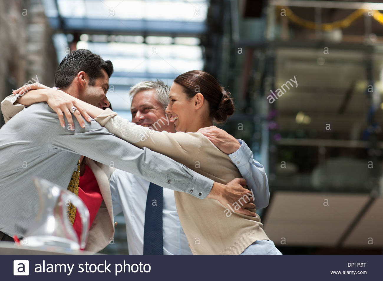 four people hugging stock photos four people hugging stock images