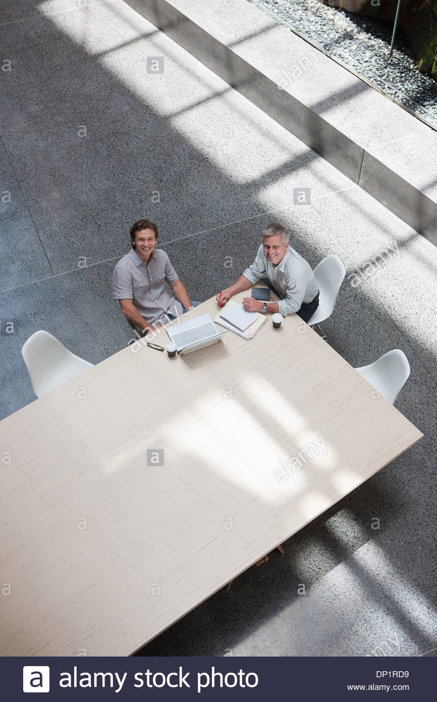 Businessmen meeting at conference table - Stock Image