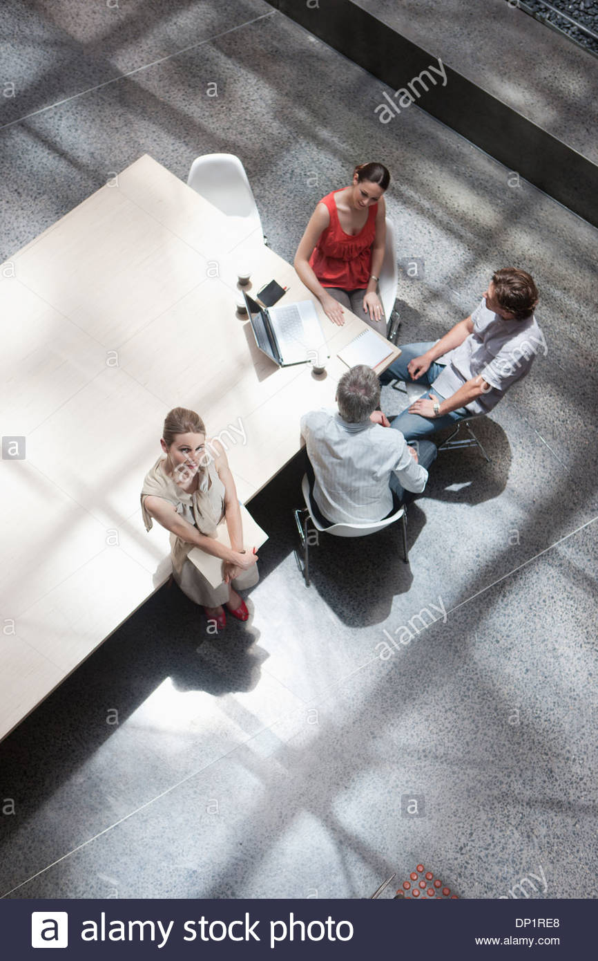 Directly above business people meeting in conference room - Stock Image