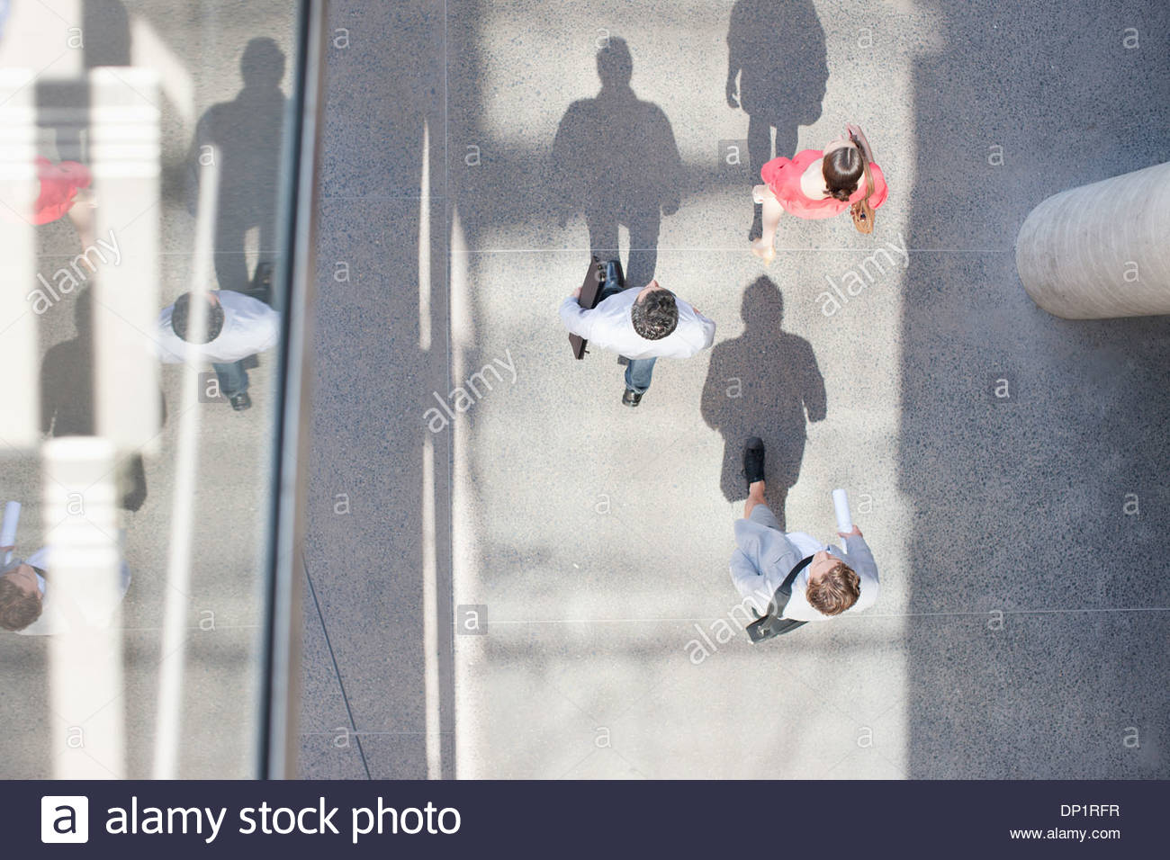 Shadows of people walking from directly above - Stock Image