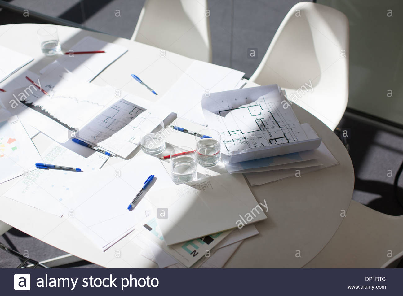 Directly above paperwork on conference table - Stock Image