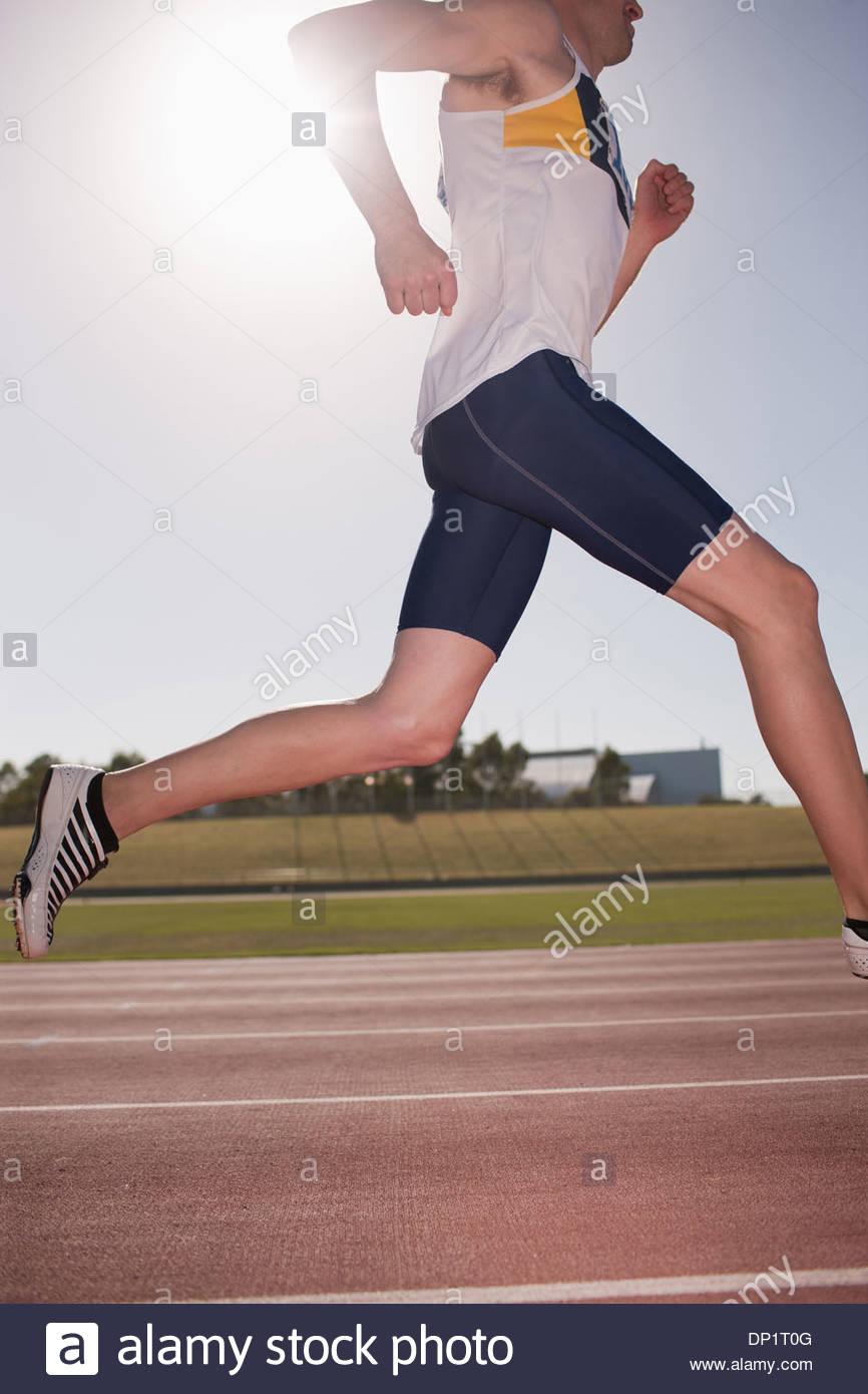Runner running on track - Stock Image