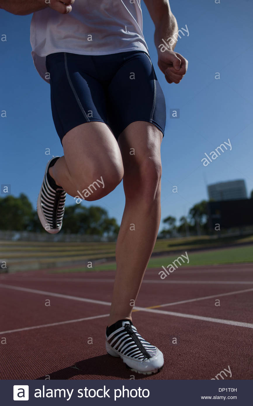 Runner running on track Stock Photo