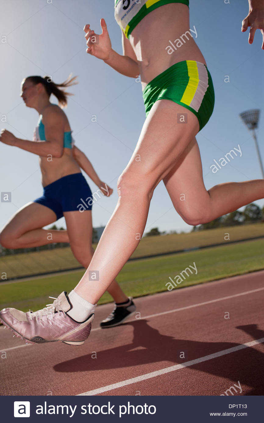 Women running on track Stock Photo