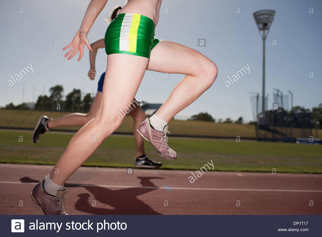 Women running on track - Stock Image