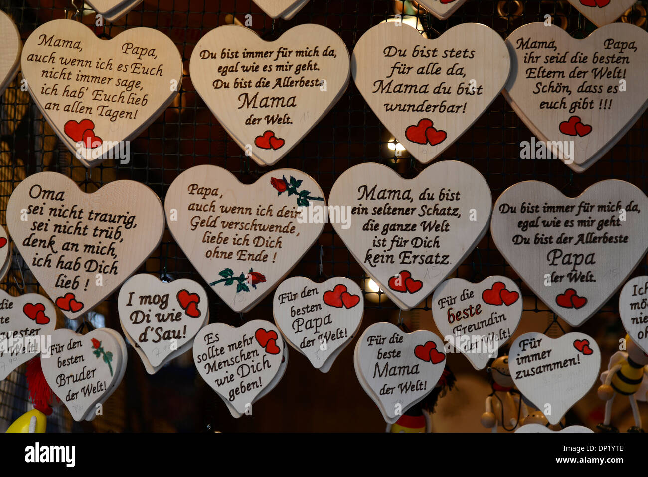 Wooden hearts with sayings in German, souvenirs at a Christmas market, Baden-Württemberg, Germany - Stock Image