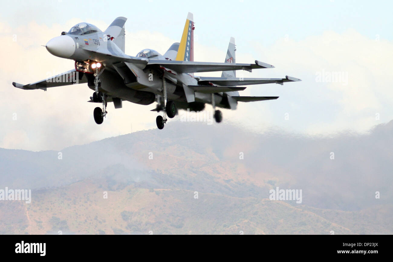 Dec 10, 2006 - Maracay, Aragua, Venezuela - Airplanes fly in formation with a Russian plane by Sukhoi, which was bought by Venezuela and presented in Maracay, Aragua state. (Credit Image: © Juan Carlos Hernandez/ZUMApress.com) - Stock Image