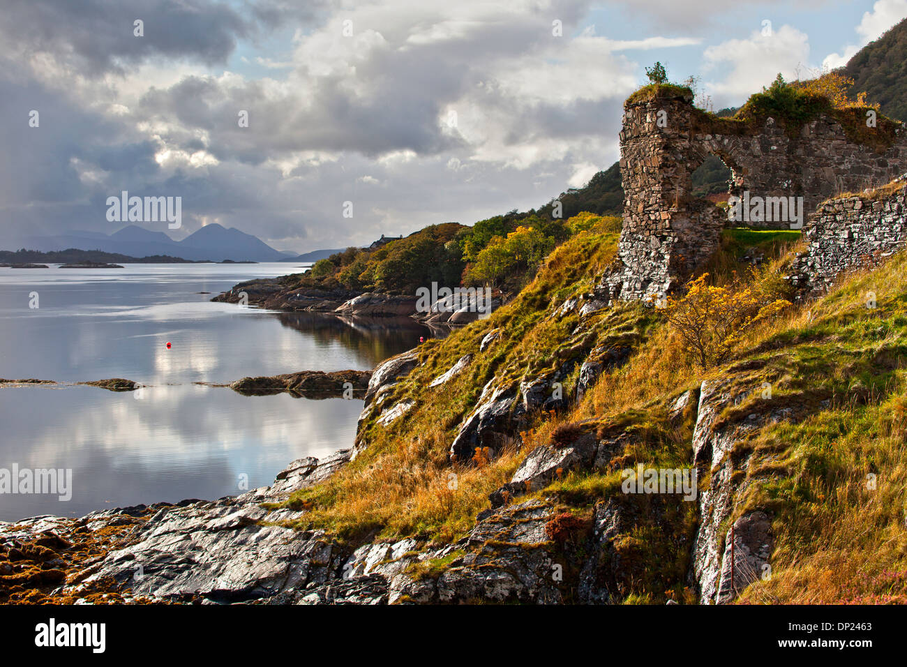 Dramatic lighting on Strome Castle a ruined castle on the shore of Lochcarron, Lochalsh, Highlands - Stock Image