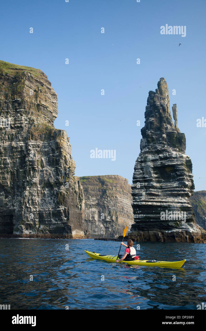 Sea kayaking beneath the Cliffs of Moher, County Clare, Ireland. - Stock Image
