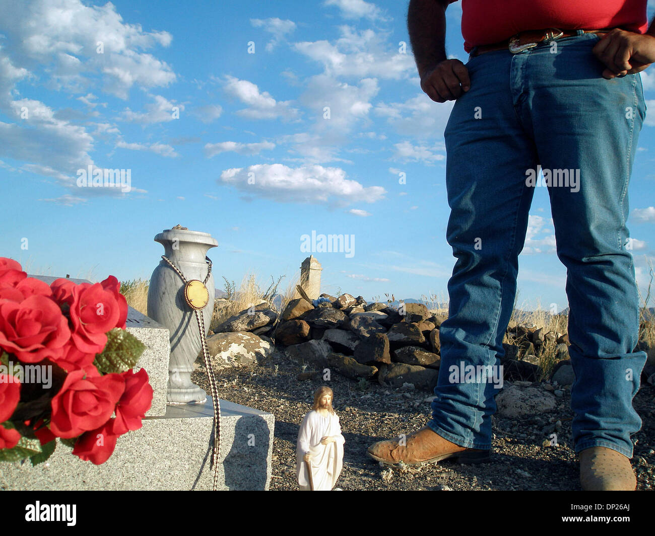 May 18, 2006; Redford, TX, USA; A bolo tie that was owned by Esequiel Hernandez Jr. hangs at his grave. Hernandez was shot to death May 20, 1997 by a U.S. Marine working with the U.S. Border Patrol near the village of Redford, Texas.Ê Mandatory Credit: Photo by Dane Schiller/San Antonio Express-News/ZUMA Press. (©) Copyright 2006 by San Antonio Express-News - Stock Image