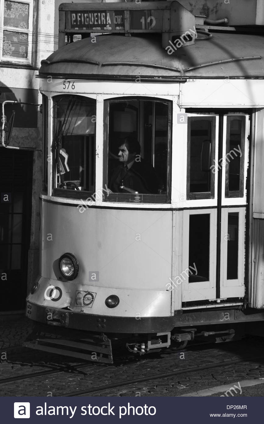 Black and white image of Tram driver, Lisbon, Portugal - Stock Image