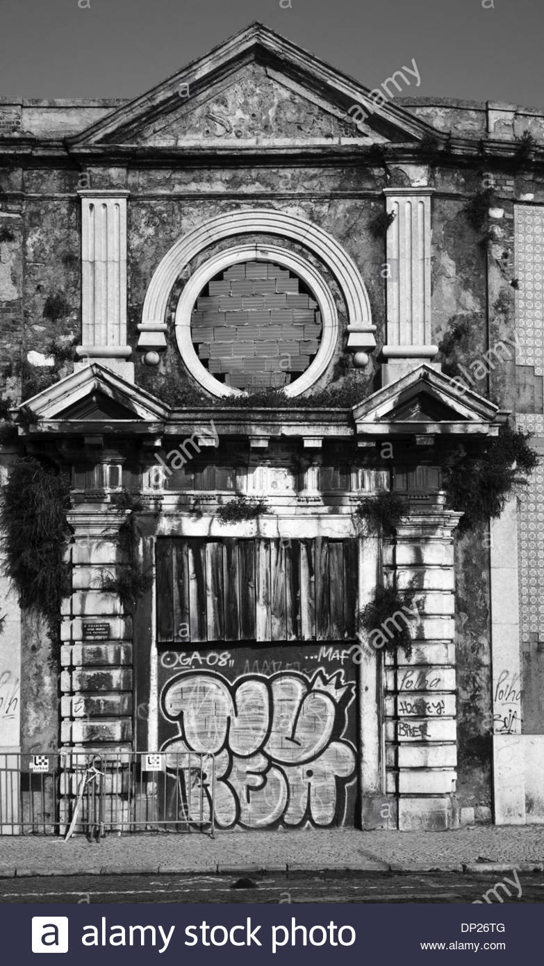 Black and white image of graffiti on derelict building, Alfama district, Lisbon, Portugal - Stock Image