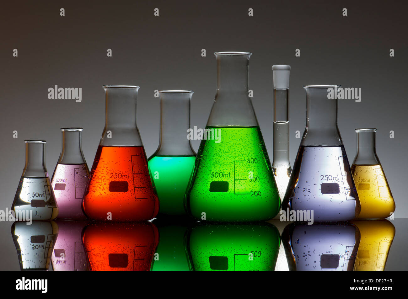 group of laboratory flasks containing liquid color - Stock Image