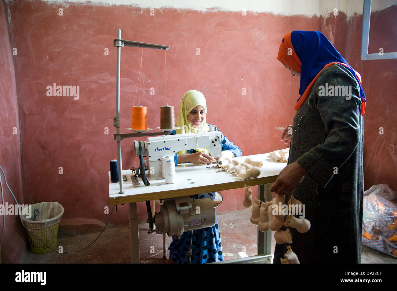 Bilbeis, Egypt: Young Egyptian women working as a seamstress at home for Sekem company in order to have a little income - Stock Image