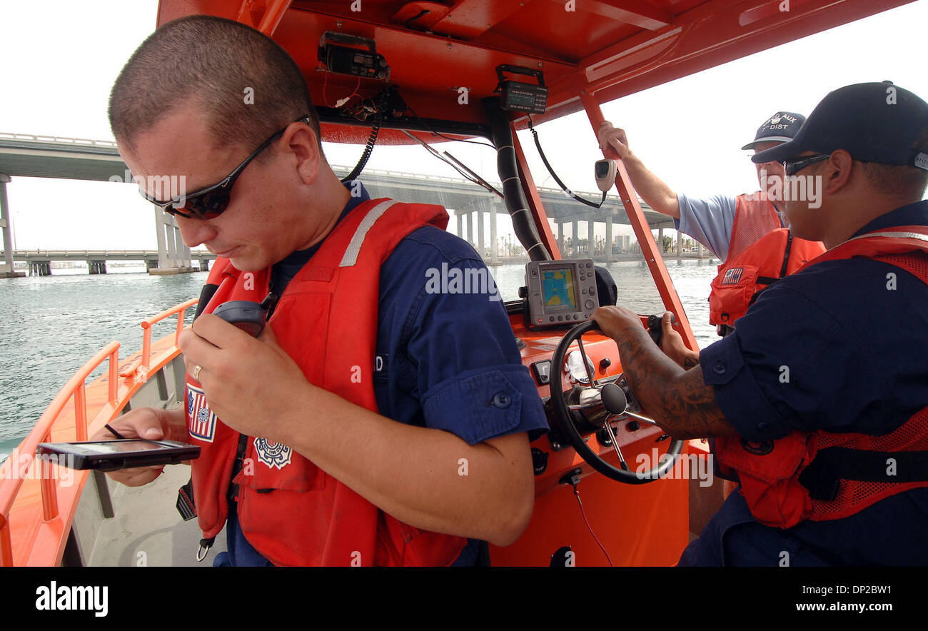 May 26, 2006; Riviera Beach, FL, USA; Coast Guard BM3 Chris Stover, 23, of Palm Beach Gardens radio's in information Stock Photo