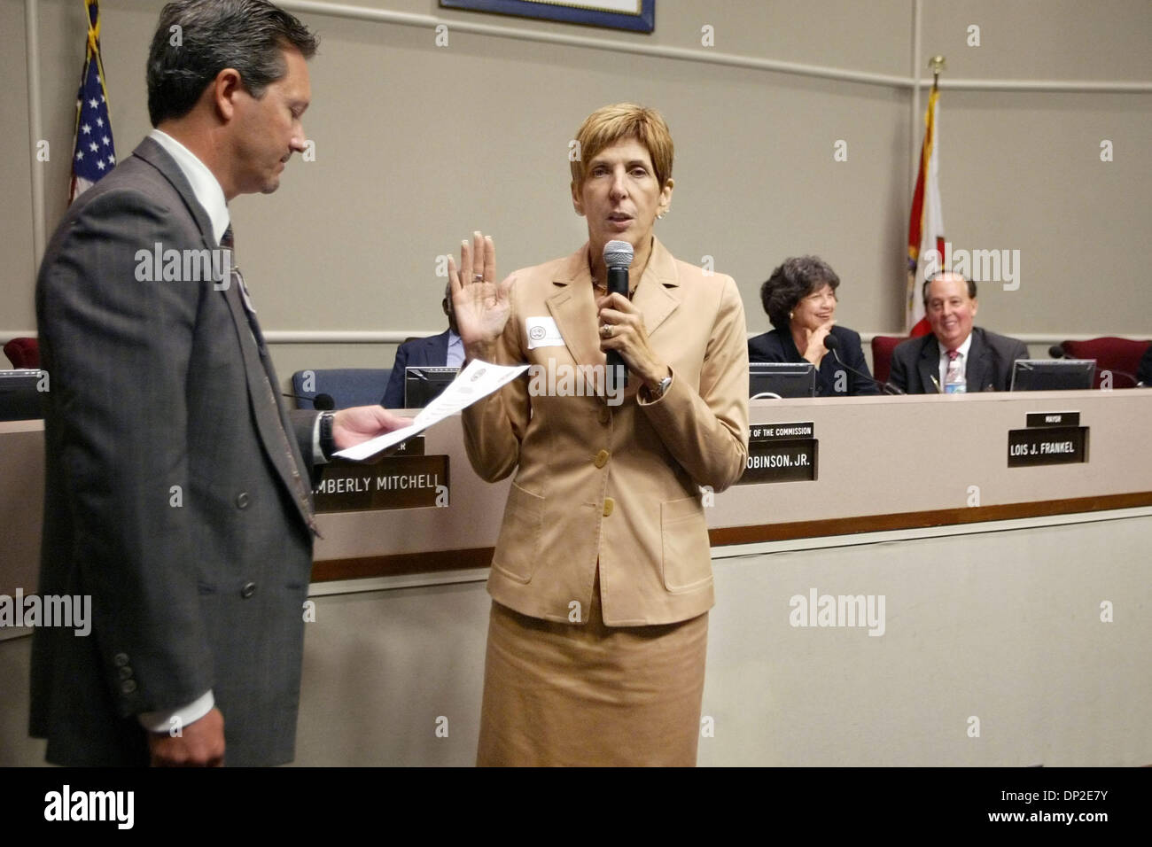 May 31, 2006; West Palm Beach, FL, USA; New West Palm Beach City Commissioner Geraldine Muoio, right is sworn in by city clerk Blane Kauthen, after being selected by Mayor Lois Frankel. Muoio replaces former district 4 commissioner Ray Liberti. Mandatory Credit: Photo by Greg Lovett/Palm Beach Post/ZUMA Press. (©) Copyright 2006 by Palm Beach Post - Stock Image