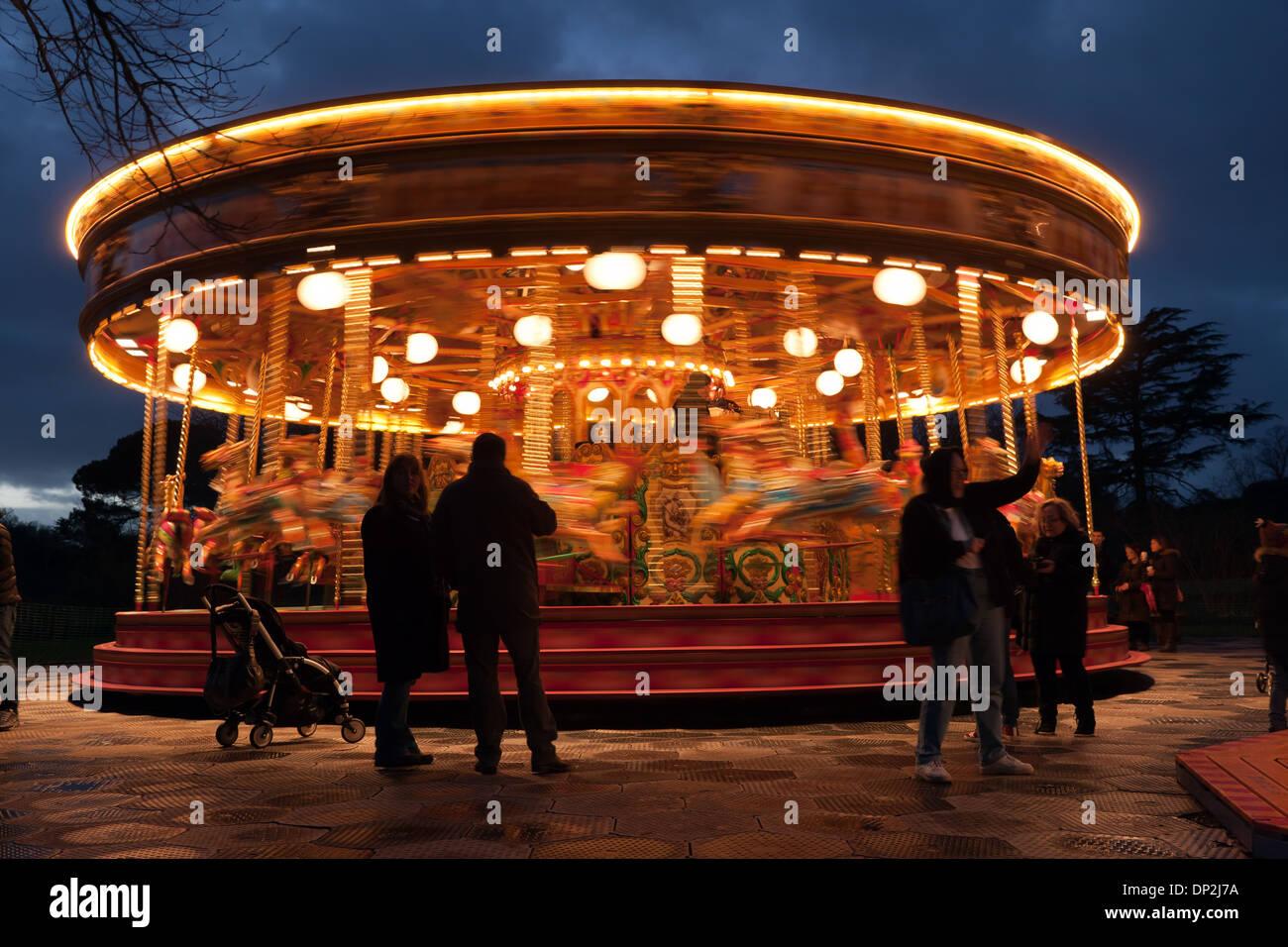 Nightime image of a Fairground Carousel. in Kew Gardens, Kew, London. - Stock Image