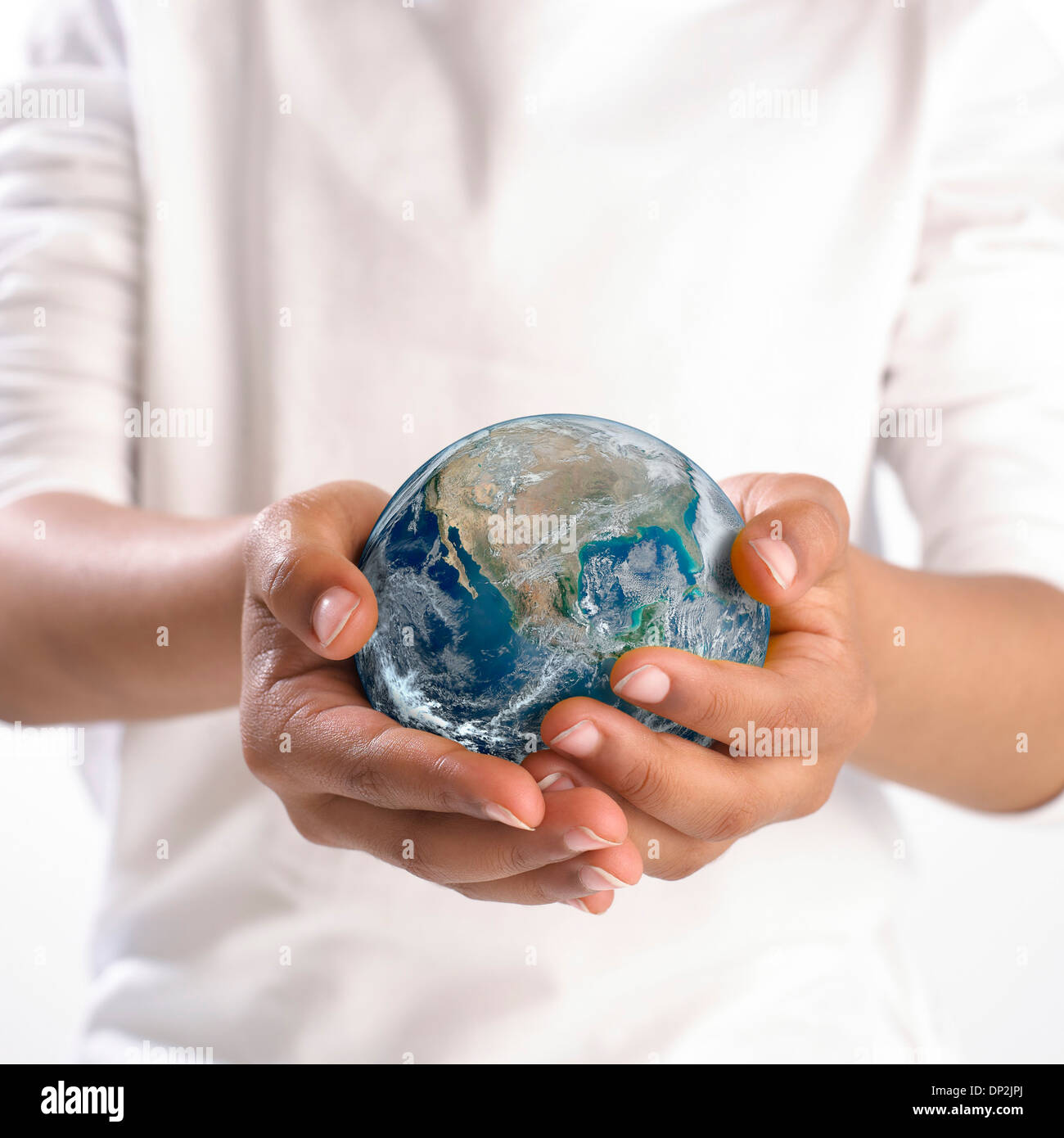 Earth held in child's hands - Stock Image