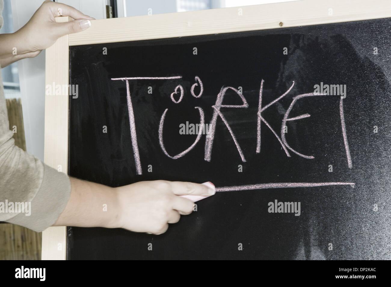 Türkei, turkey written on blackboard (model-released) Stock Photo