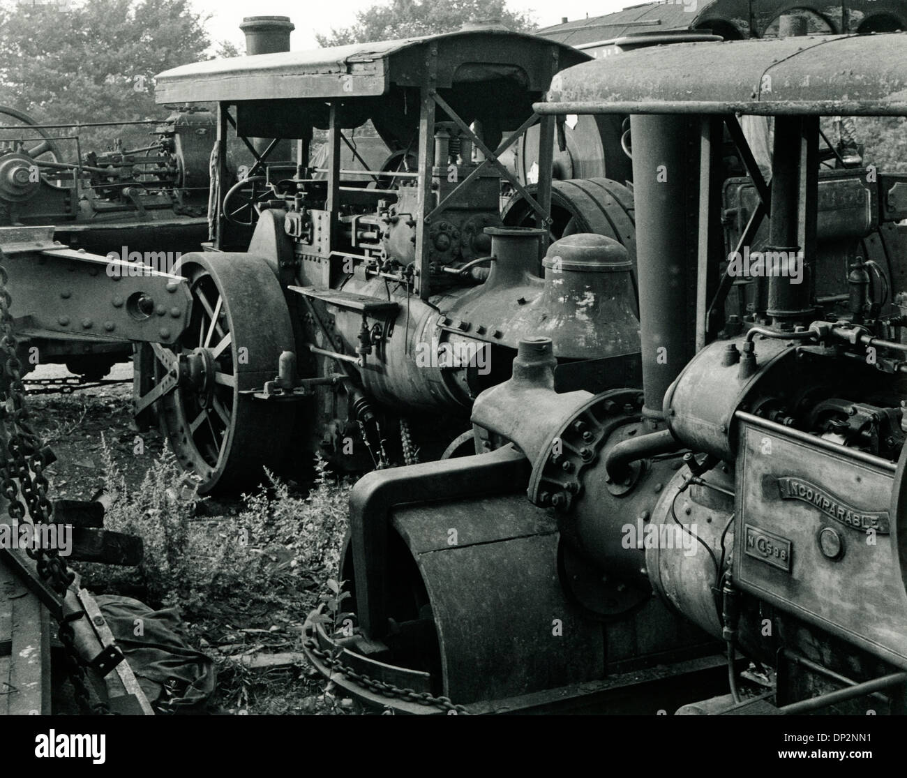 steam traction engines in a scrapyard rotting away - Stock Image