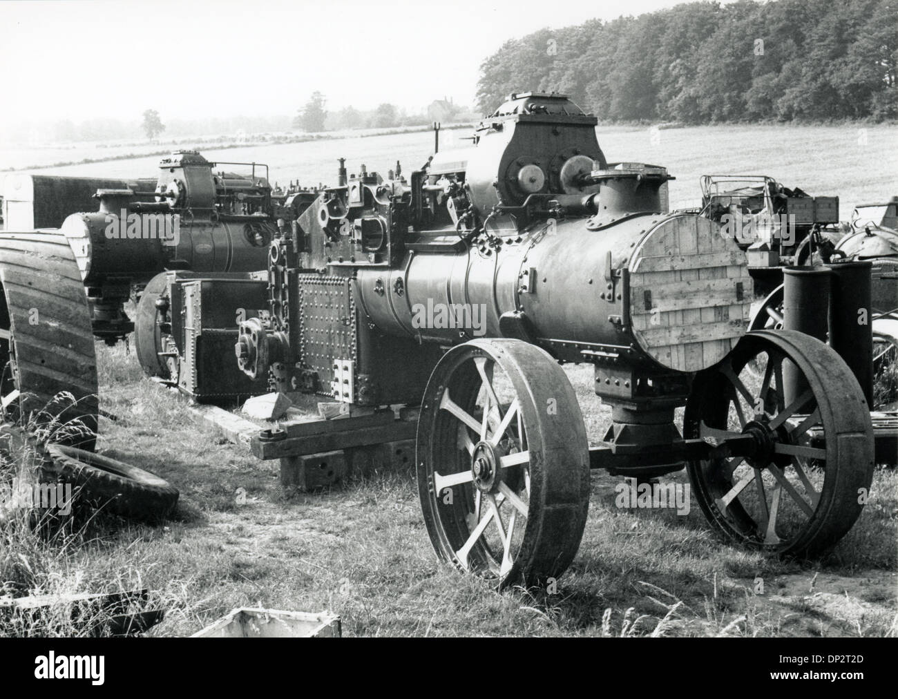 dismantled steam driven traction engines in a field - Stock Image