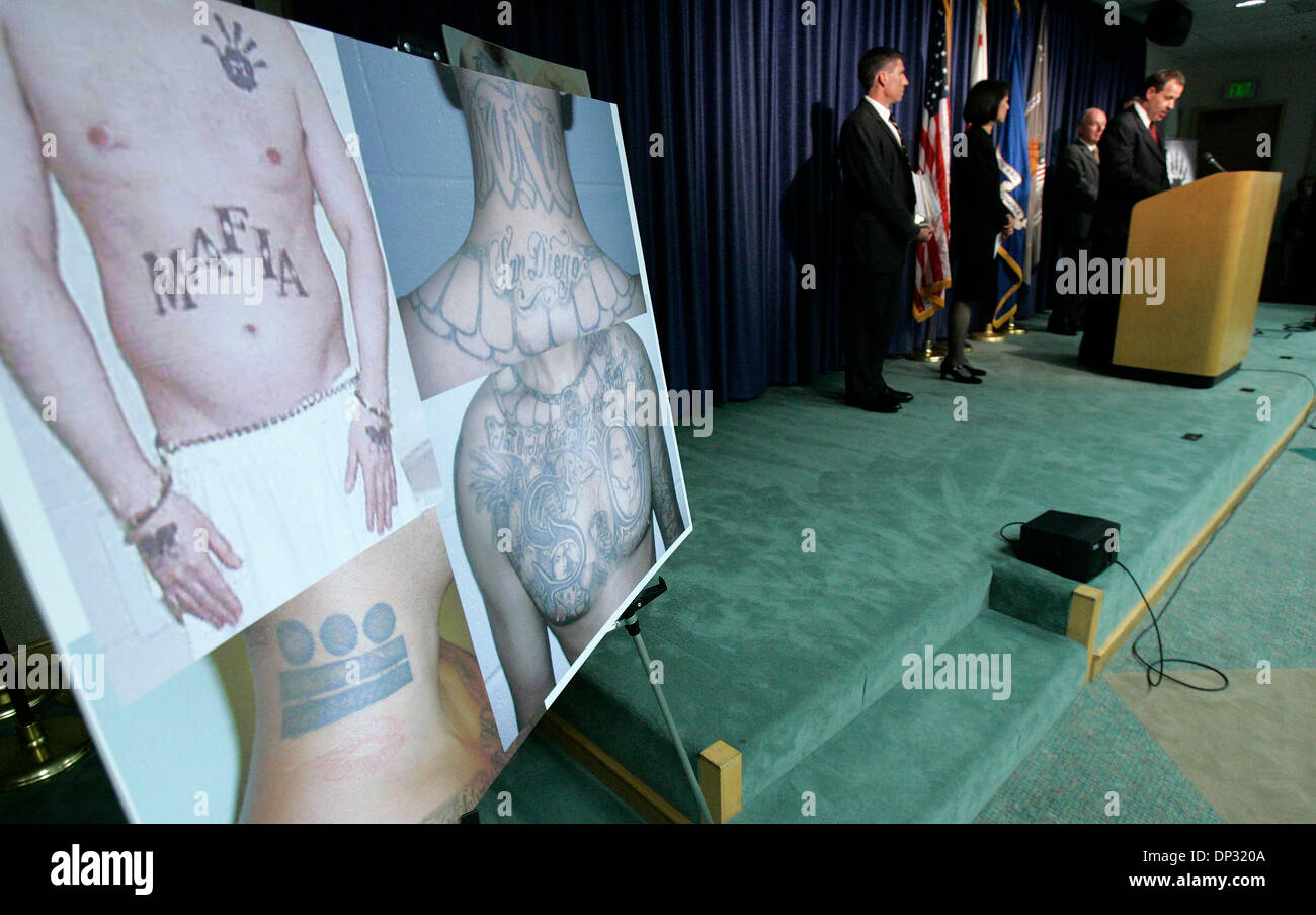 Jun 16, 2006; San Diego, CA, USA; DANIEL DZWILEWSKI, the special agent in charge of San Diego's office of the FBI, addresses the media near photos of tattoes of apprehended members of the Mexican Mafia Friday. Members of federal, county and local law enforcement assisted in the inditement and apprehension of more than 30 members of the Mexican Mafia, a notorious gang born of Califo - Stock Image