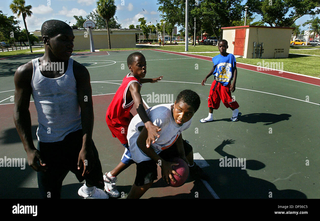 Jun 22, 2006; Miami, FL, USA; Alexander McDuffie, 14, tries to make a move on his friends at Marva Y. Bannerman park in Miami's Liberty City area just blocks away from the home where Udonis Haslem often stayed with his aunt Jackie Newsom during his high school years.  McDuffie, a huge fan of Haslem and the Heat, can quote a list of statistics and facts about Haslem, including his 2 - Stock Image