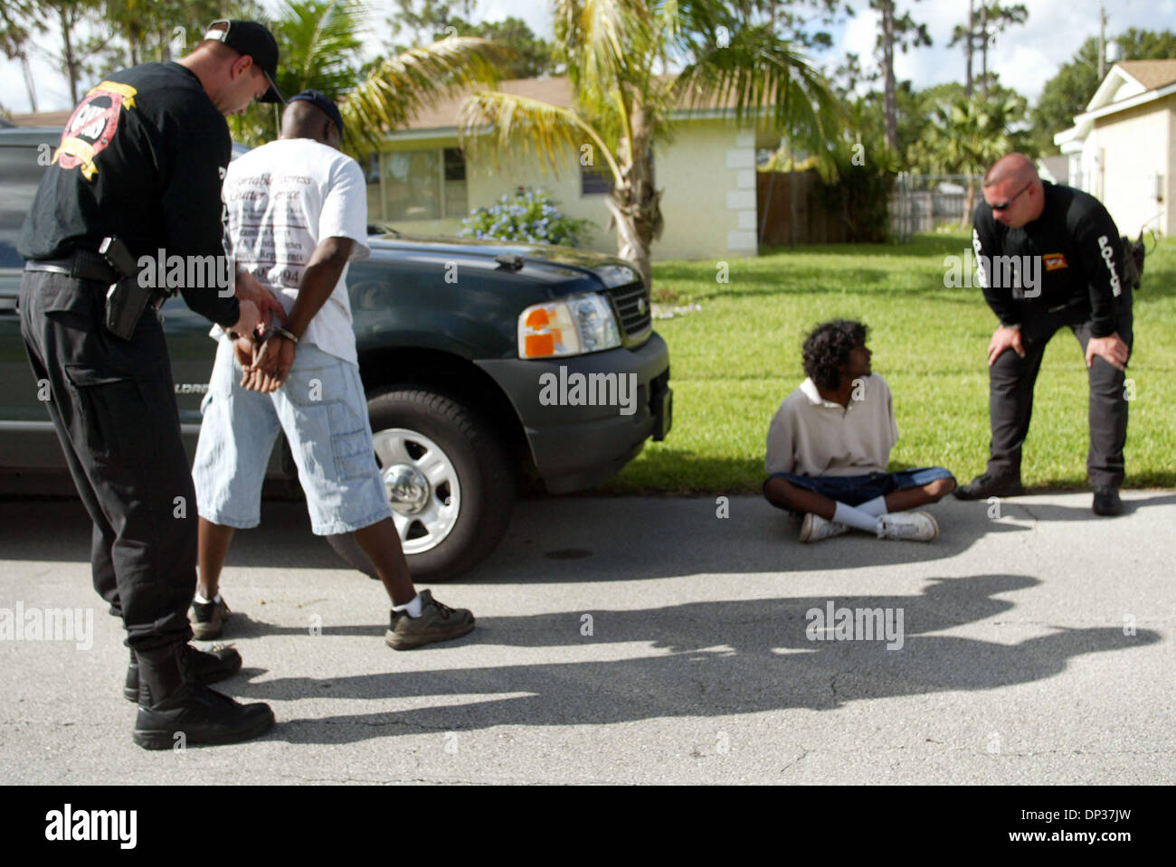 Jun 23, 2006; Port St. Lucie, FL, USA; This was the first mission of an anti-gang task force, which is comprised of members of the Port St. Lucie and Fort Pierce police departments and the St. Lucie County Sheriff's Office. All four suspects they sought were arrested. Mandatory Credit: Photo by Vada Mossavat/Palm Beach Post/ZUMA Press. (©) Copyright 2006 by Palm Beach Post - Stock Image