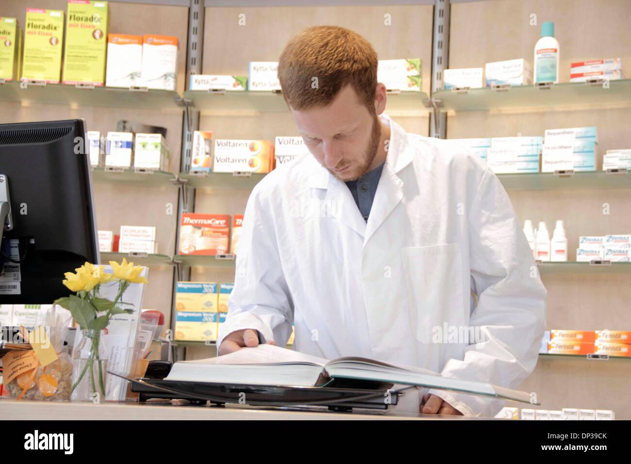 Pharmacist reading - Stock Image