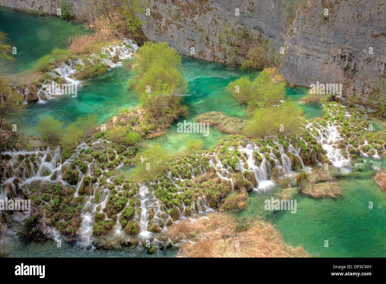 Blue-green waterfalls. Plitvice Lakes National Park, Croatia Water-colored from limestone and travertine - Stock Image
