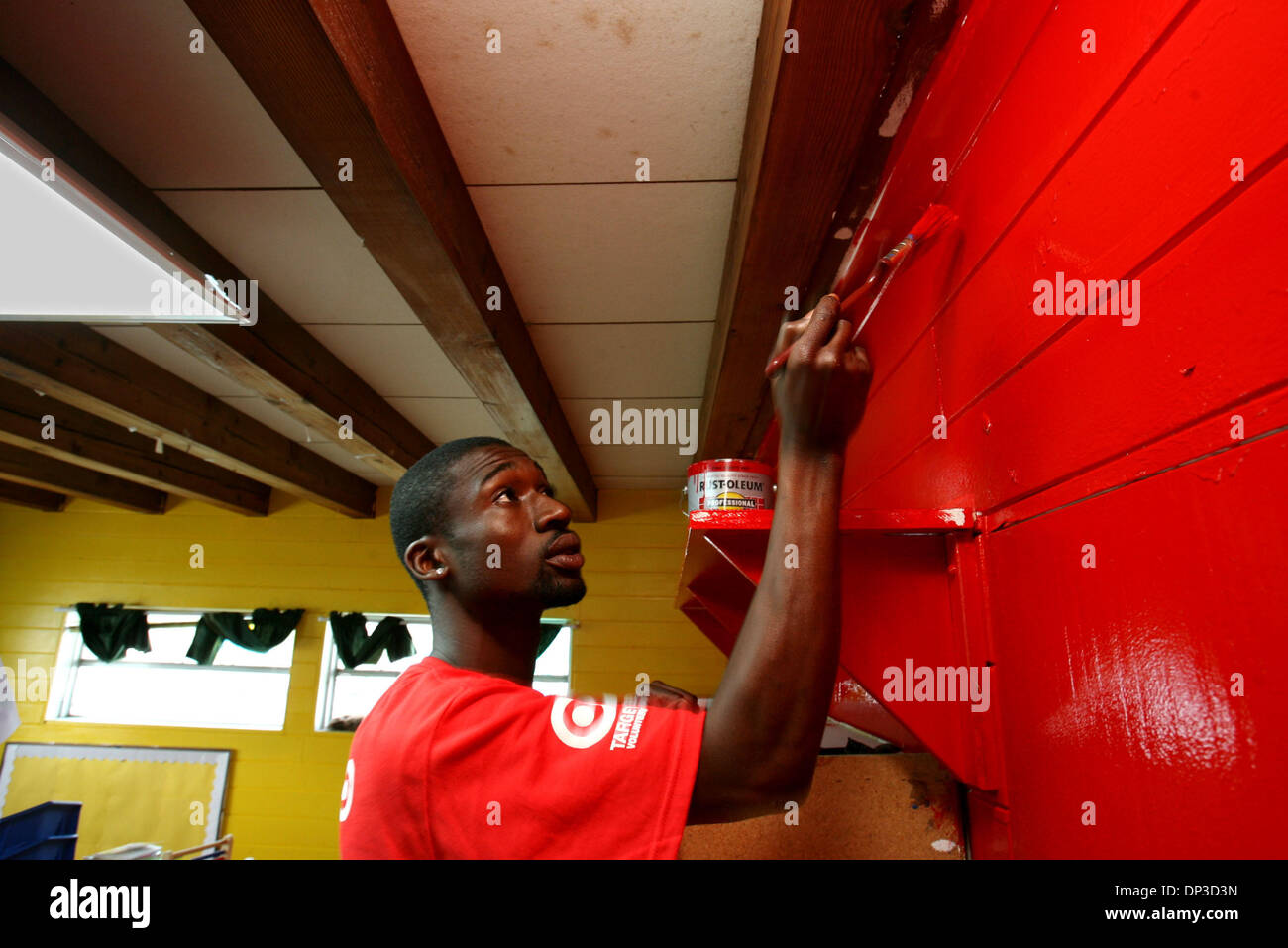 Jun 29, 2006; Palm Springs, FL, USA; Target employee Ulysses Anderson, 26, of West Palm Beach, volunteers at 'the day of giving back to the community' painting a classroom at the YMCA of the Palm Beaches in Palm Springs Thursday. Around 35 employees from Target stores in northern Broward County and Palm Beach County volunteered painting, improving the landscape and donating toys. A - Stock Image