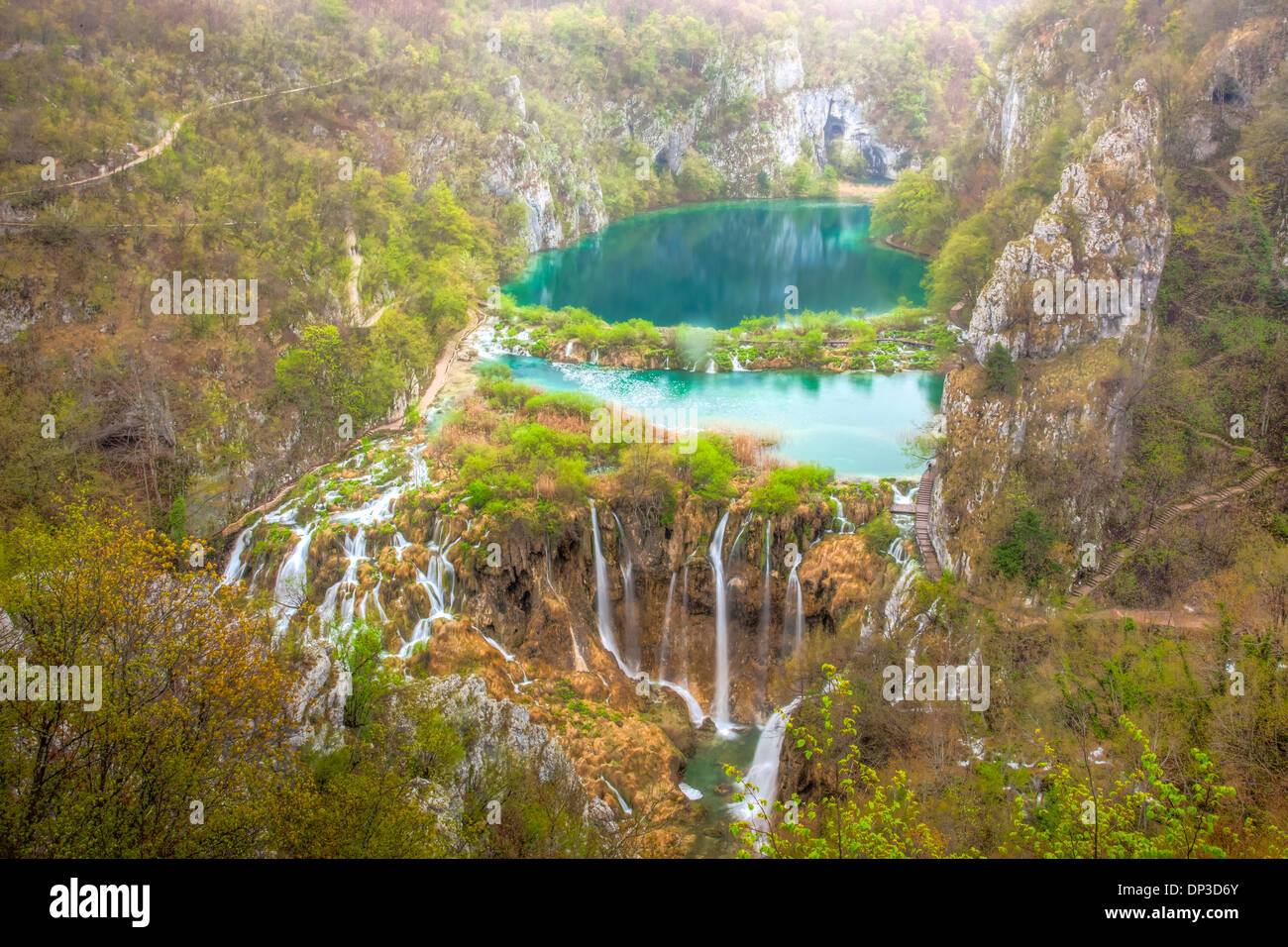 Blue-green waterfalls Plitvice Lakes National Park Croatia Water-colored from limestone and travertine - Stock Image