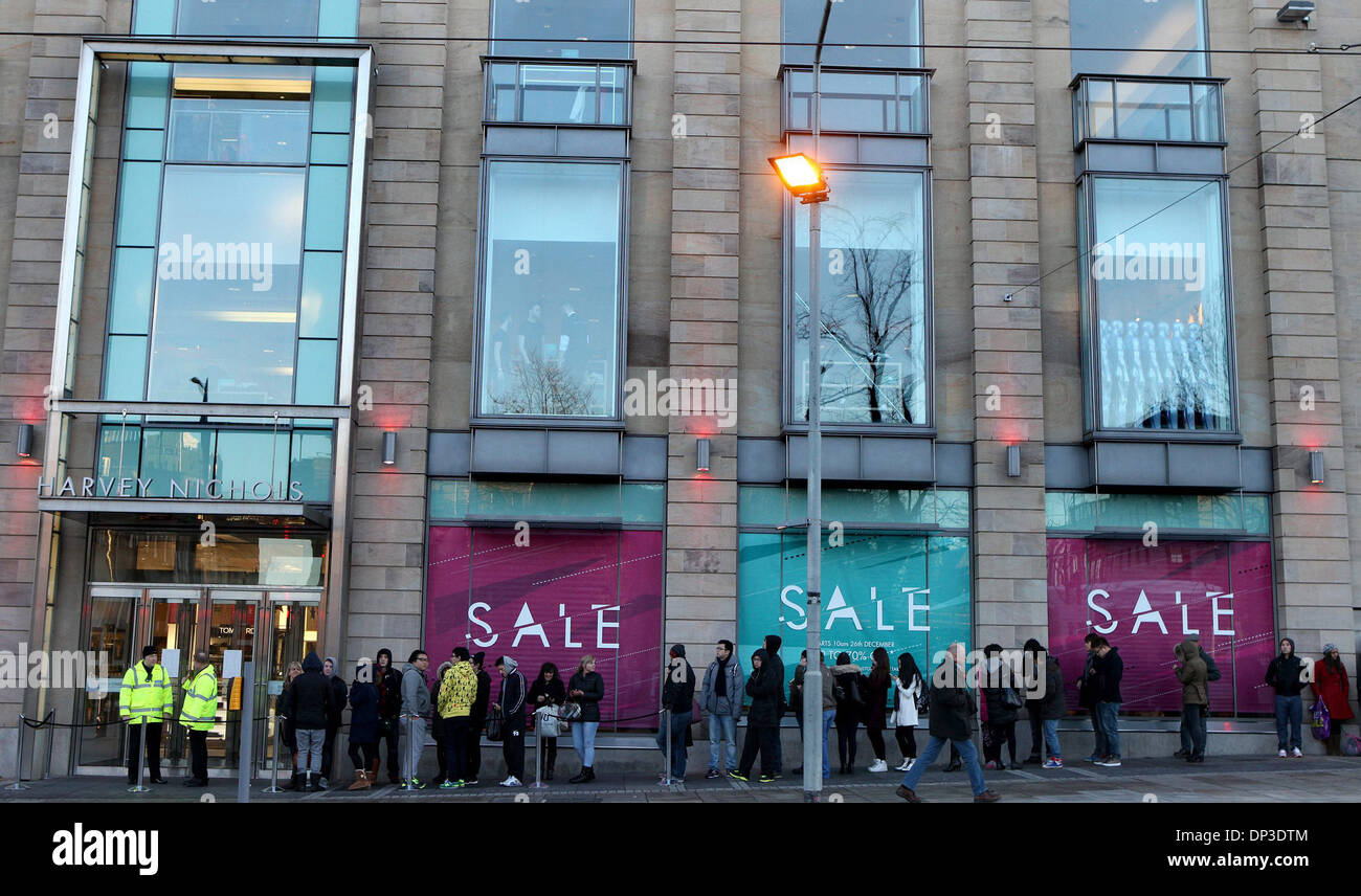 Hundreds of bargain hunters flood into Harvey Nichols in Edinburgh for the Boxing Day Sales. 26/12/13 - Stock Image