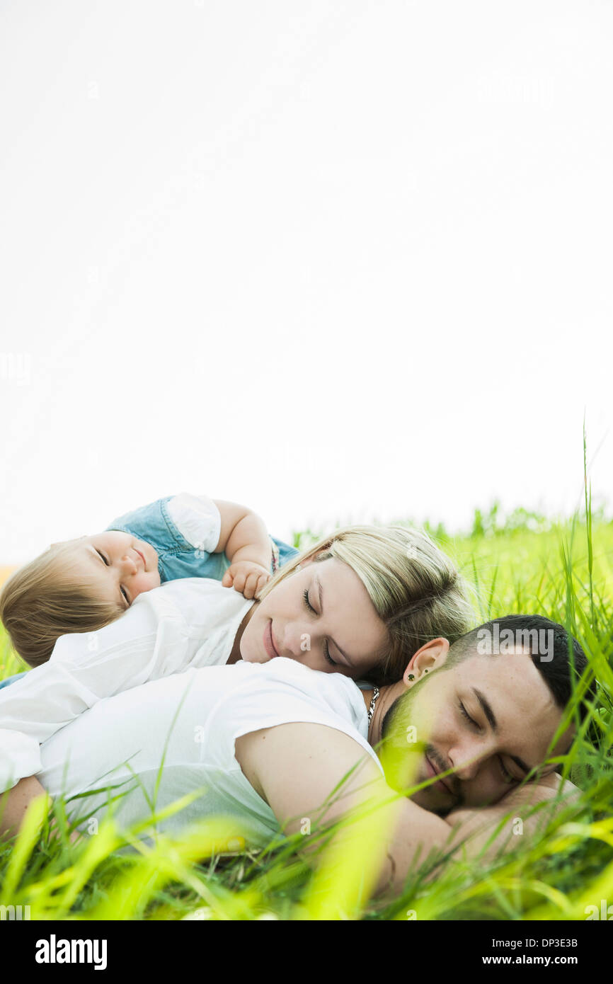 Family Sleeping in Grass, Mannheim, Baden-Wurttemberg, Germany Stock Photo