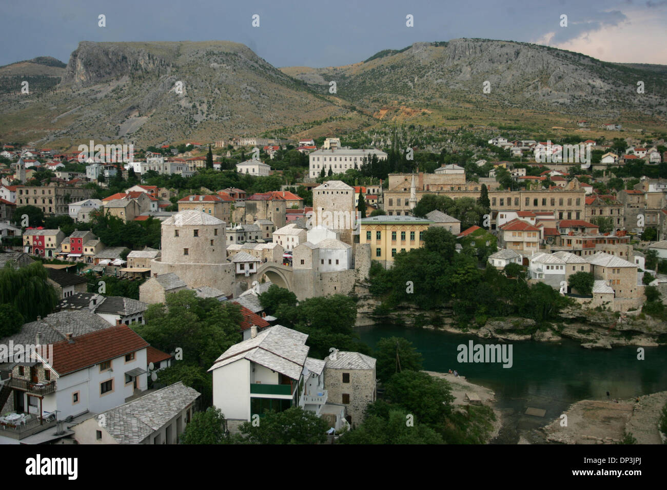 Jul 11, 2006; Mostar, BOSNIA AND HERZEGOVINA; The unofficial capital of Herzegovina, Mostar is situated on the Neretva river and is the fifth-largest city in the country. Mostar was named after its Old Bridge (Stari most) and the towers on its sides, 'the bridge keepers.' Founded in the late 15th century, Mostar was the chief administrative city for the Ottoman Empire in the Herzeg - Stock Image