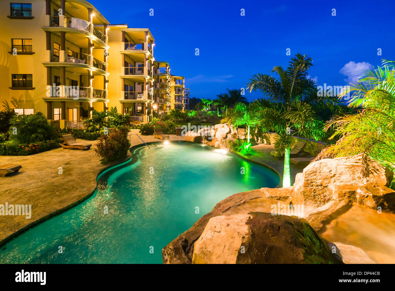 Architectural photo of hotel condo units and swimming pool dusk - Stock Image