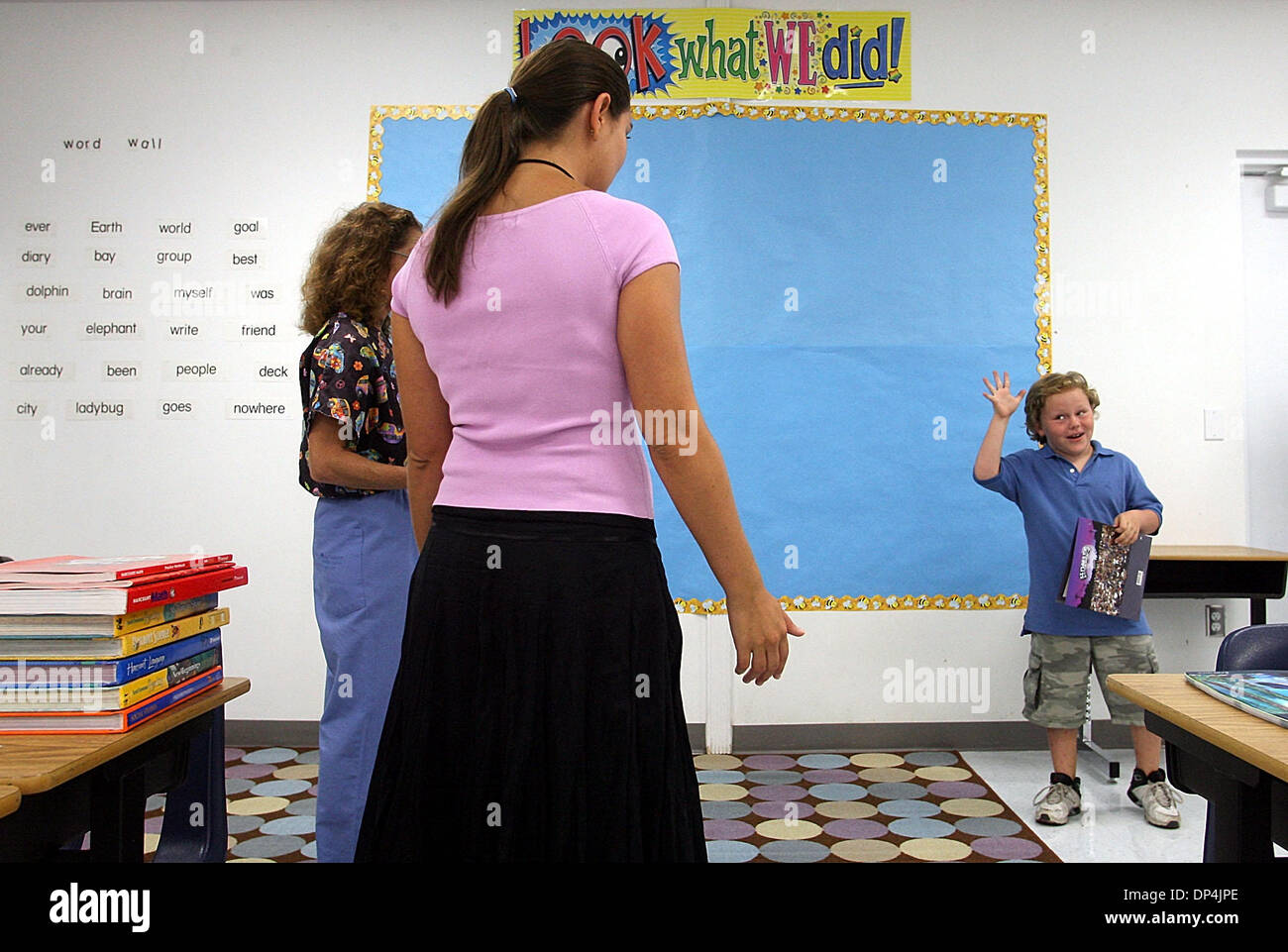Aug 15, 2006; Boca Raton, FL, USA; achary Graham-Levine, 7, gives a precocious  wave goodbye to first-year 2nd-grade teacher Paige Schildkraut after Meet the Teacher Day at Addison Mizner Elementary School in Boca Raton Tuesday, Aug. 15, 2006. Meet the Teacher Day was Wed. and Paige got to meet many of her students for the first time and introduce herself to their parents. Mandator - Stock Image
