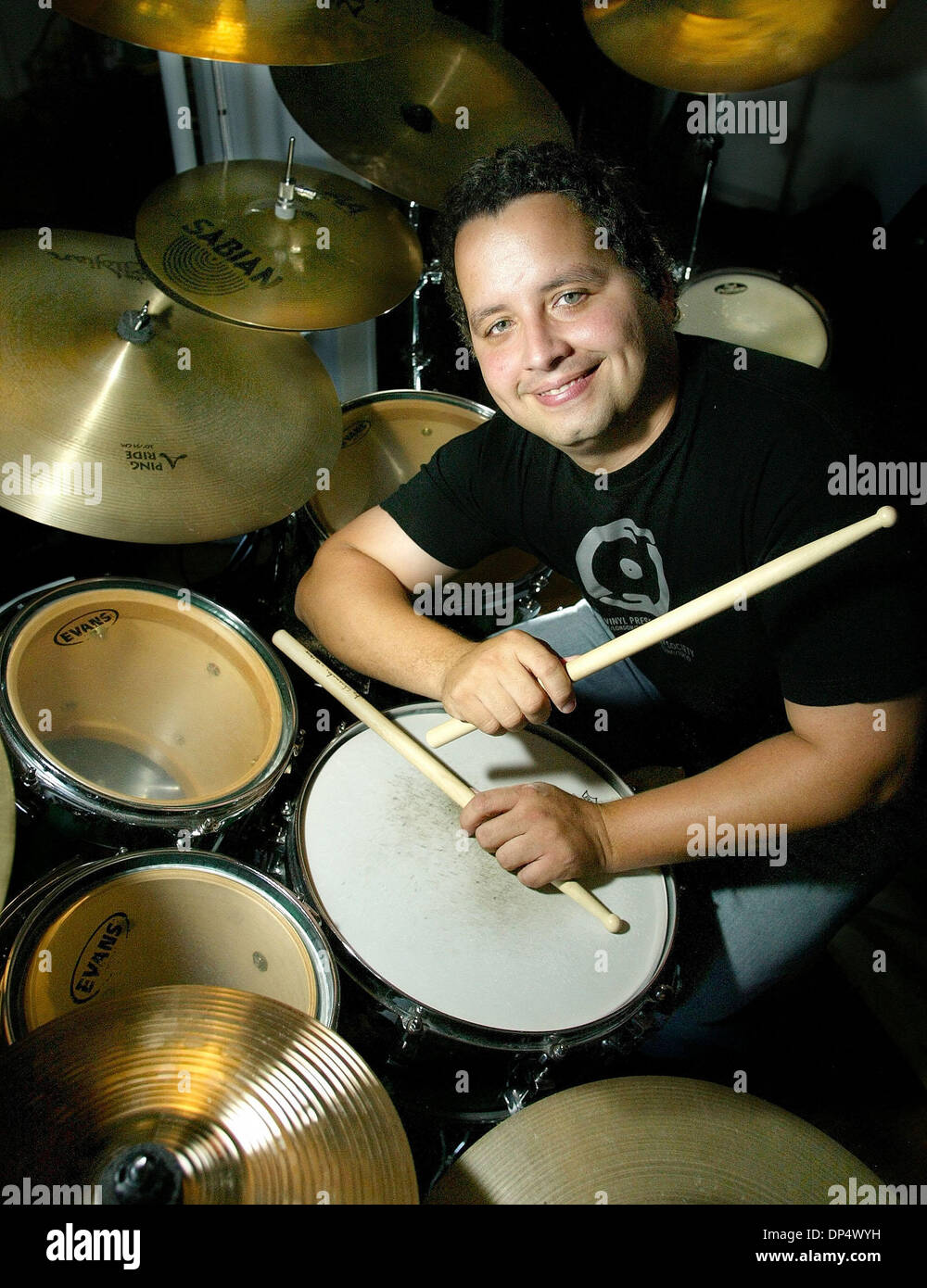 Aug 26, 2006; West Palm Beach, FL, USA; Drummer Angel Luis Lozada, 35, Saturday morning at his West Palm Beach studio. Lozada originally from Toa Baja, Puerto Rico, moved to West Palm Beach in 1993 and is presently the drummer for Doorway 27, a reggae funk rock band.  Mandatory Credit: Photo by Bill Ingram/Palm Beach Post/ZUMA Press. (©) Copyright 2006 by Palm Beach Post - Stock Image
