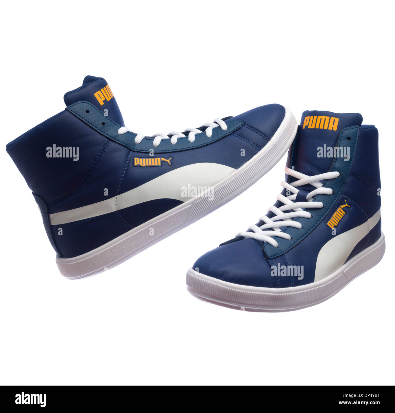 Blue retro Puma shoes isolated on white background - Stock Image 4572f9a647a8
