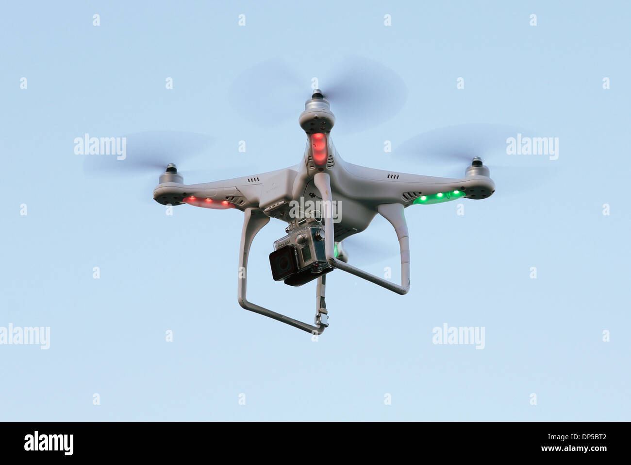 A remote-controlled DJI Phantom video drone in flight. - Stock Image