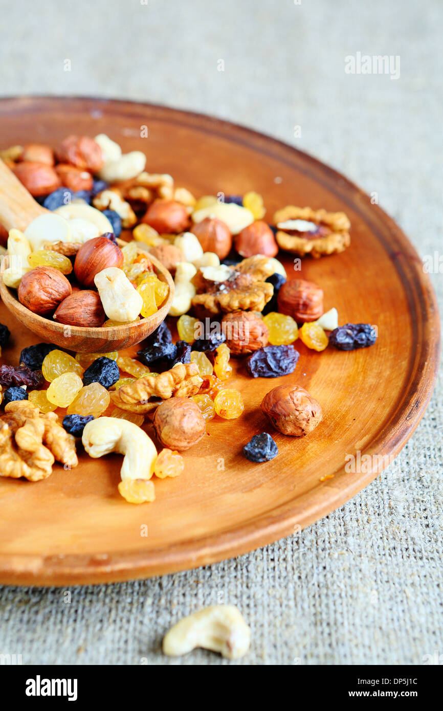 Mixed nuts on platter, food healthy - Stock Image