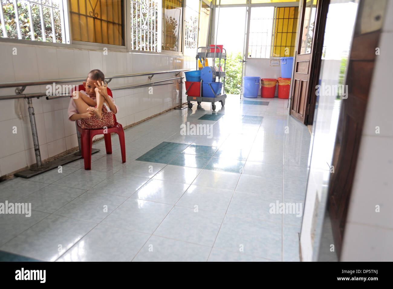 A disabled child is at the Peace Village in Tudu Hospital in Ho Chi Minh City, Vietnam. - Stock Image
